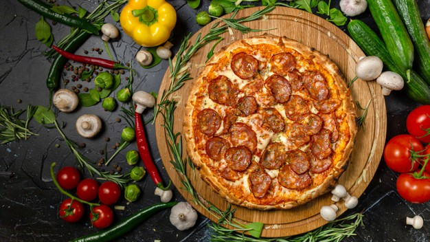 tasty-pepperoni-pizza-cooking-ingredients-tomatoes-basil-black-concrete-background-top-view-hot-pepperoni-pizza-with-copy-space-text-flat-lay-banner_363394-73